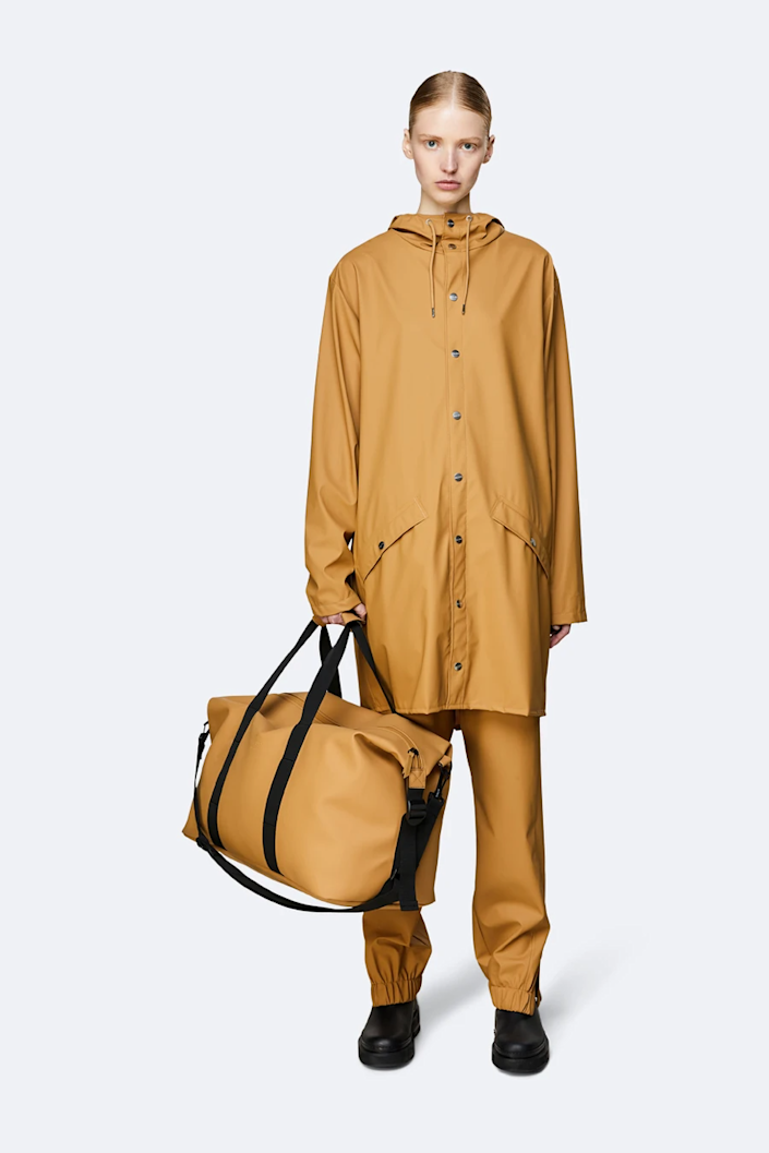 """<h2>Rains Weekend Bag</h2><br>Traveling somewhere rainy? This slick duffle is made from 100% waterproof fabric and features a water-resistant zipper to keep all of your valuables safe and dry. <br><br><em>Shop <strong><a href=""""https://www.us.rains.com/"""" rel=""""nofollow noopener"""" target=""""_blank"""" data-ylk=""""slk:Rains"""" class=""""link rapid-noclick-resp"""">Rains</a></strong></em><br><br><strong>Rains</strong> Weekend Bag, $, available at <a href=""""https://go.skimresources.com/?id=30283X879131&url=https%3A%2F%2Fwww.us.rains.com%2Fproducts%2Fweekend-bag"""" rel=""""nofollow noopener"""" target=""""_blank"""" data-ylk=""""slk:Rains"""" class=""""link rapid-noclick-resp"""">Rains</a>"""