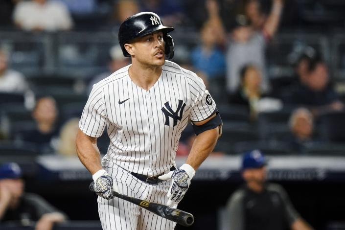 New York Yankees' Giancarlo Stanton watches his sacrifice fly ball that drove in a run during the third inning of a baseball game against the Texas Rangers, Monday, Sept. 20, 2021, in New York. (AP Photo/Frank Franklin II)
