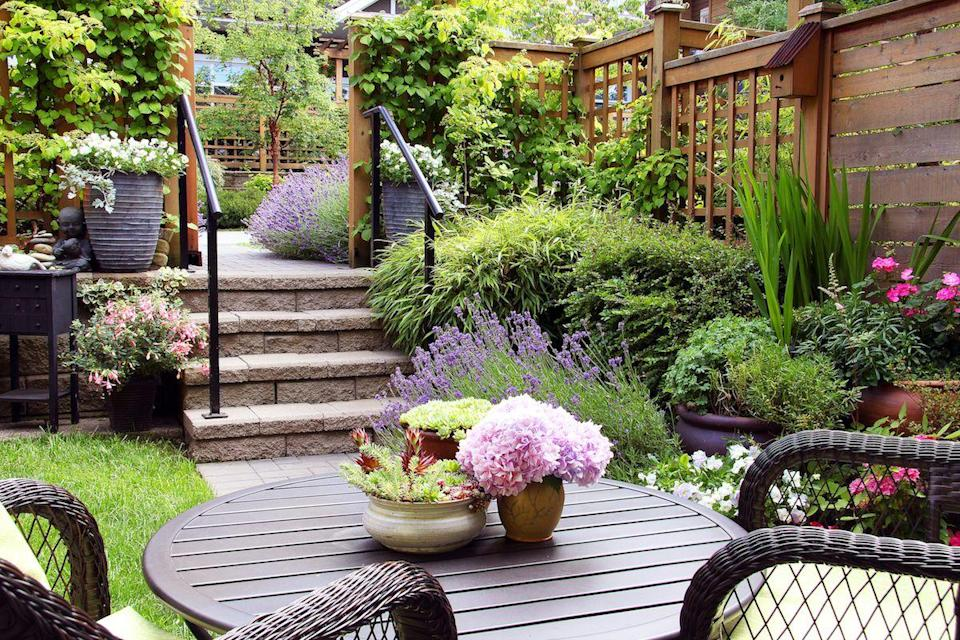 """<p>Crafting a <a href=""""https://www.goodhousekeeping.com/home/gardening/tips/g1226/small-outdoor-space-decor/"""" rel=""""nofollow noopener"""" target=""""_blank"""" data-ylk=""""slk:small outdoor space"""" class=""""link rapid-noclick-resp"""">small outdoor space</a> is never easy, but it's not impossible. Even if you're not lucky enough to call Versailles home, you can still make your tiny patch of green look stunning. With a dose of creativity and a few smart furniture choices, your humble garden can be picture-perfect in no time, thanks to these brilliant space-saving outdoor ideas design ideas. </p><p>Not sure where to begin? This roundup has genius garden hacks, stylish decor and <a href=""""https://www.goodhousekeeping.com/home/gardening/advice/g2258/perfect-potted-plants/"""" rel=""""nofollow noopener"""" target=""""_blank"""" data-ylk=""""slk:unique planters"""" class=""""link rapid-noclick-resp"""">unique planters</a> that will give a petite space some grand style. These small garden ideas have more than enough inspiration to bring style to your home, regardless of your design aesthetic. </p>"""
