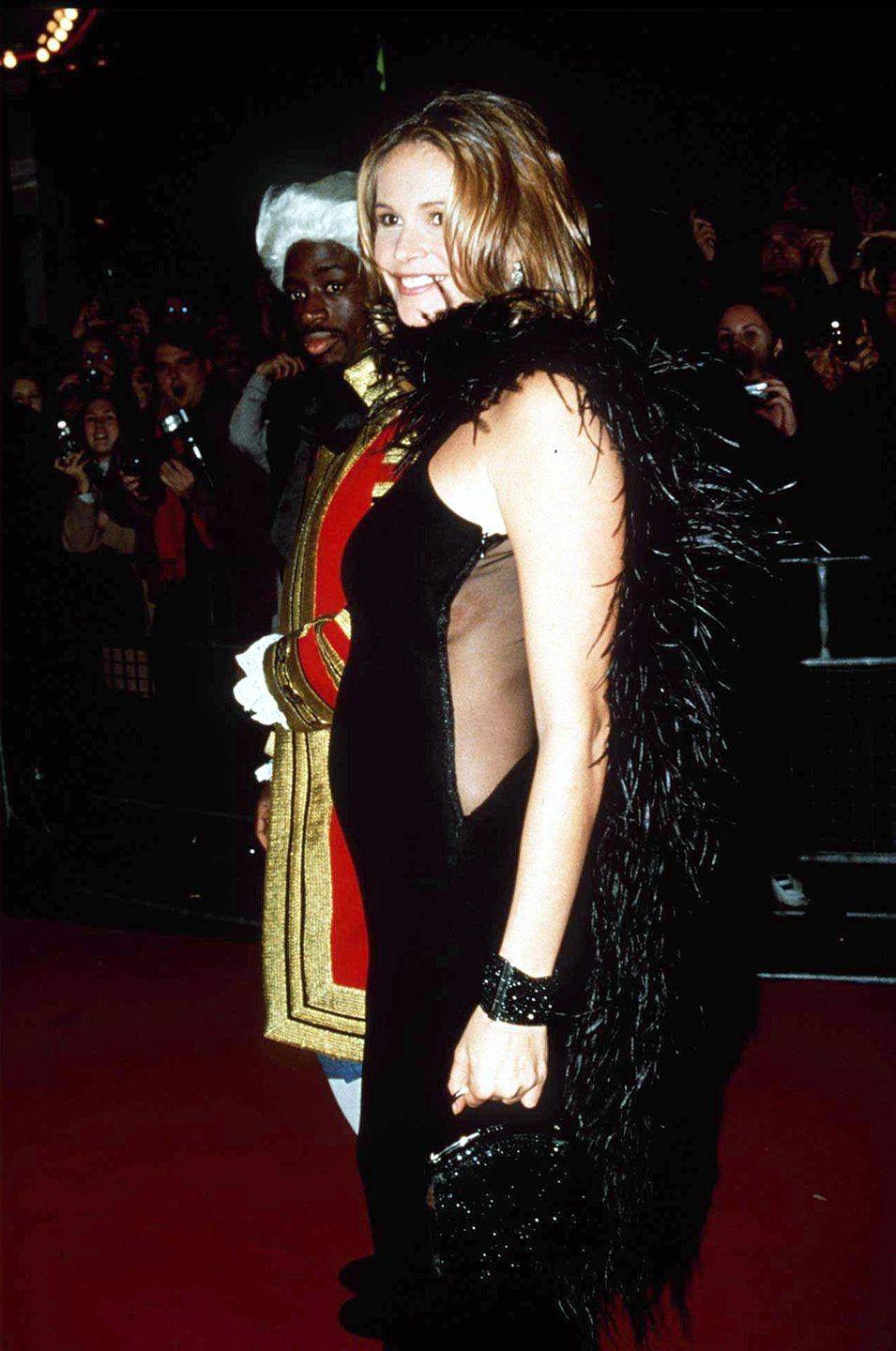 <p>Pregnant bodies were celebrated in the '90s like never before. With so many high profile celeb moms-to-be, designers took note and the maternity fashion market boomed accordingly. Models, like Elle Macpherson here, eschewed baggy, oversized garb for more slim-fitting silhouettes that highlighted their changing shape.</p>