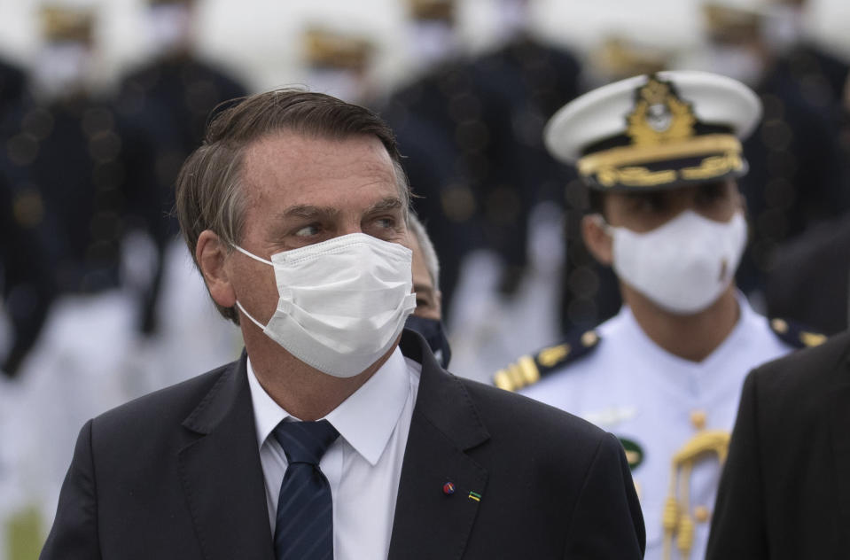 Brazilian President Jair Bolsonaro attends a graduation ceremony at the Naval Academy, in Rio de Janeiro, Brazil, Saturday, June 19, 2021, amid the COVID-19 pandemic. People gathered across the country Saturday, to protest Bolsonaro's handling of the pandemic and economic policies protesters say harm the interests of the poor and working class. (AP Photo/Silvia Izquierdo)