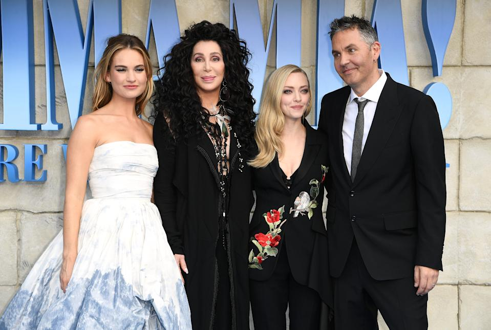 Lily James (left), Cher (second left) and Amanda Seyfried and Director Ol Parker (right) attending the premiere of Mamma Mia! Here We Go Again held at the Eventim Hammersmith Apollo, London. Photo credit should read: Doug Peters/EMPICS