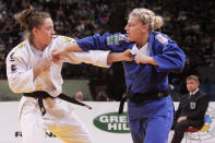 Kayla Harrison of U.S.A, blue jersey, fights with Marhinde Verkerk of Netherlands, during their women's under 78 kg category third place match at the World Judo Championships in Paris Friday, Aug. 26, 2011. Kayla Harrison won bronze. (Photo/Markus Schreiber)
