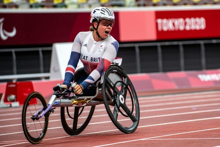 Britain's Hannah Cockroft reacts after winning gold in the women's 100m T34 final (AFP/Philip FONG)