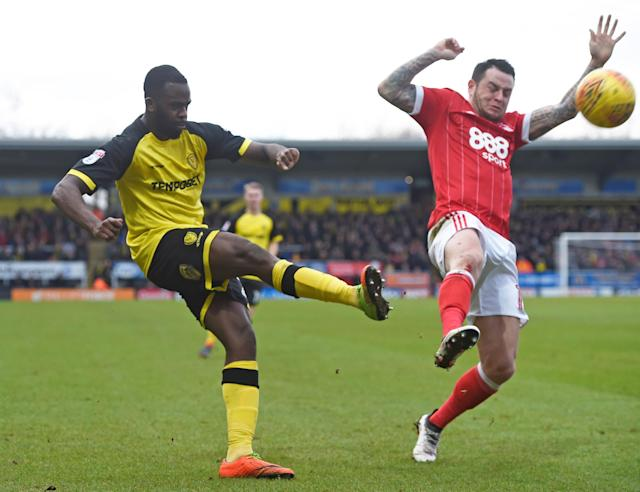 "Soccer Football - Championship - Burton Albion vs Nottingham Forest - Pirelli Stadium, Burton-on-Trent, Britain - February 17, 2018 Burton's Lucas Akins in action with Nottingham Forest's Lee Tomlin Action Images/Alan Walter EDITORIAL USE ONLY. No use with unauthorized audio, video, data, fixture lists, club/league logos or ""live"" services. Online in-match use limited to 75 images, no video emulation. No use in betting, games or single club/league/player publications. Please contact your account representative for further details."