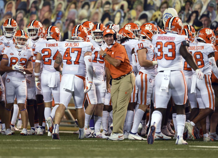 Clemson coach Dabo Swinney celebrates with the defense after a Wake Forest turnover in an NCAA college football game Saturday, Sept. 12, 2020, in Winston-Salem, N.C. (Walt Unks/The Winston-Salem Journal via AP)