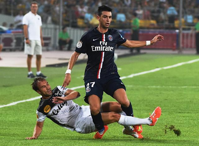 Paris Saint-Germain's Javier Pastore (R) competes for the ball with Guingamp's Maxime Baca during the French season-opening Champions Trophy match in Beijing on August 2, 2014 (AFP Photo/Greg Baker)