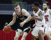 Wake Forest's Jonah Antonio (20) tries to get around North Carolina State's Thomas Allen (5) during the first half of an NCAA college basketball game Wednesday, Jan. 27, 2021, in Raleigh, N.C. (Ethan Hyman/The News & Observer via AP, Pool)