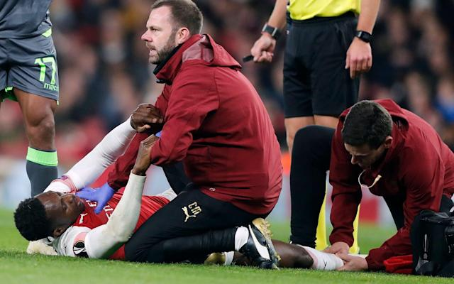 Danny Welbeck is attended by medics on the pitch - AP