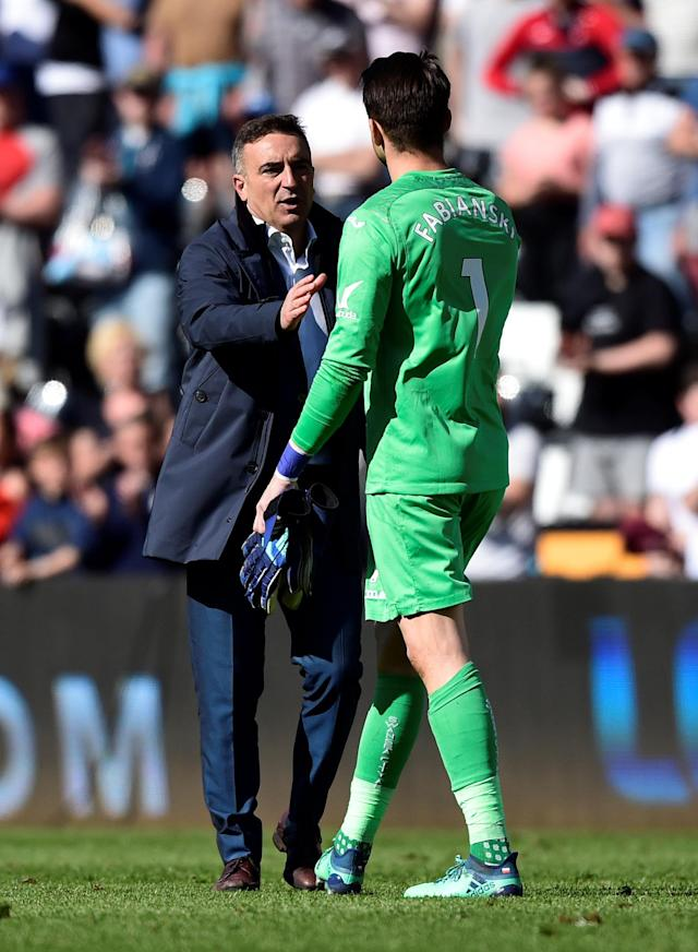 "Soccer Football - Premier League - Swansea City vs Stoke City - Liberty Stadium, Swansea, Britain - May 13, 2018 Swansea City manager Carlos Carvalhal shakes hands with Lukasz Fabianski after the match as they are relegated from the Premier League REUTERS/Rebecca Naden EDITORIAL USE ONLY. No use with unauthorized audio, video, data, fixture lists, club/league logos or ""live"" services. Online in-match use limited to 75 images, no video emulation. No use in betting, games or single club/league/player publications. Please contact your account representative for further details."