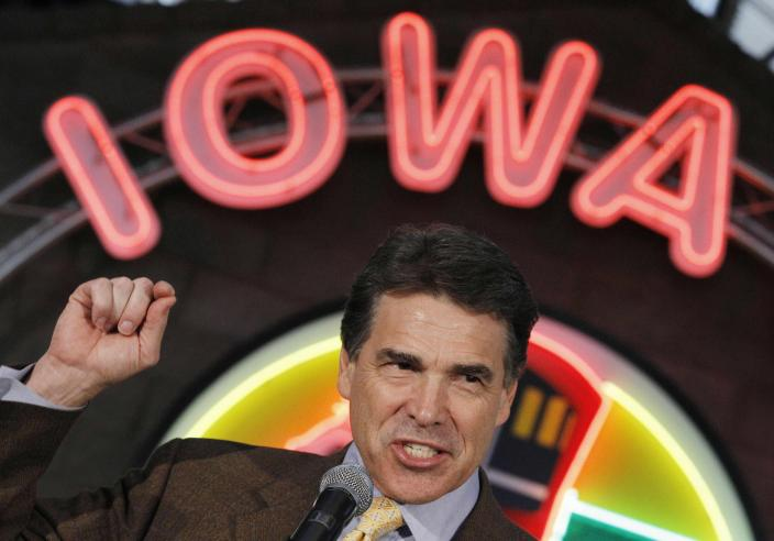FILE - In this Aug. 16, 2011 file photo, Republican presidential candidate, Texas Gov. Rick Perry, makes a campaign stop at the Iowa 80 Group in Walcott, Iowa. Perry announced Monday, July 8, 2013, that he would not seek re-election as Texas governor next year. (AP Photo/Charles Dharapak, File)