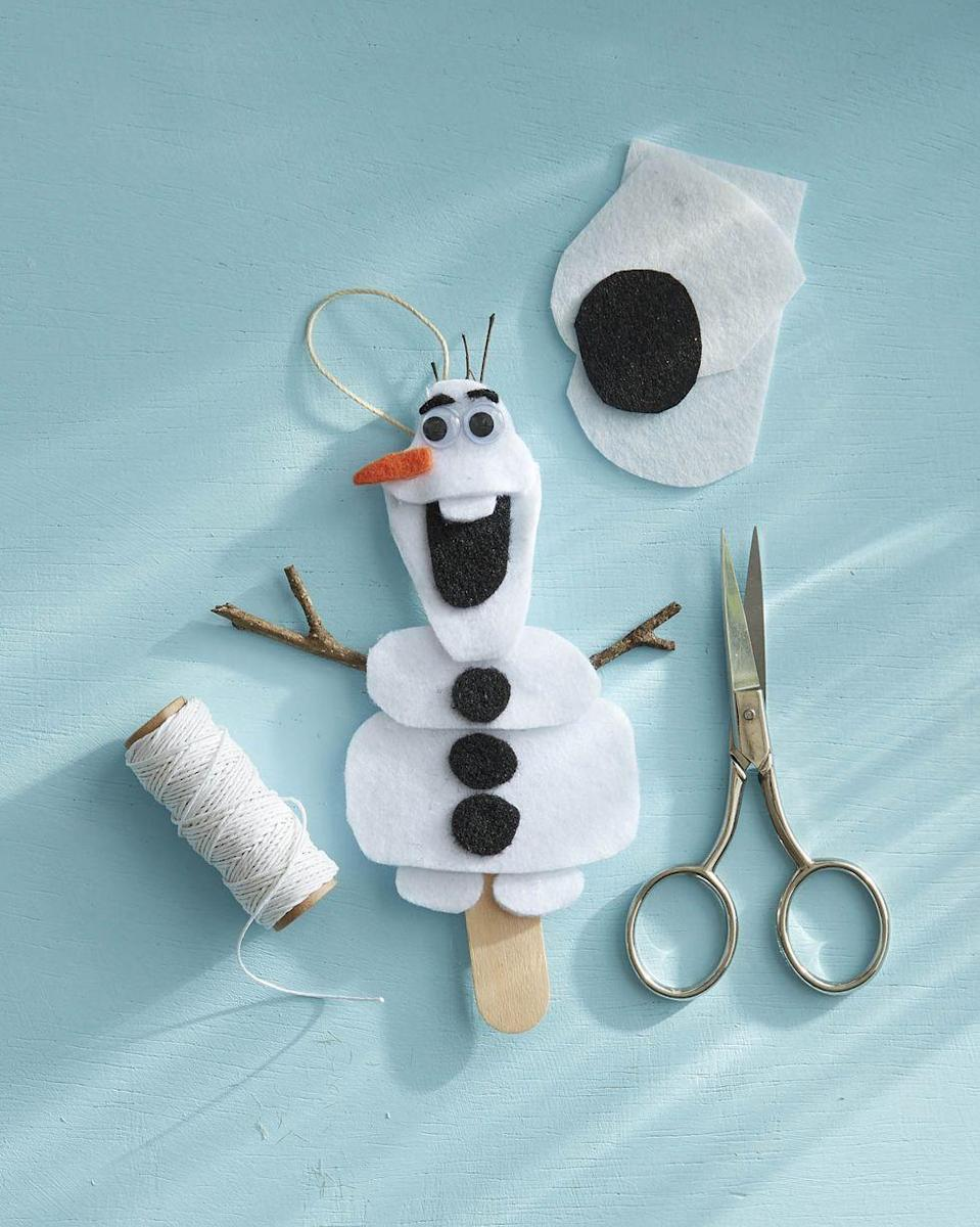 """<p>Your young ones will love this fuzzy ornament that represents the loveable, iconic snowman from the hit movie <em>Frozen</em>.</p><p><strong>To make:</strong> Cut body shapes from white felt; attach to a tongue depressor with hot glue. Cut buttons, mouth and eyebrows from black felt; attach to body with hot glue. Glue mini googly eyes below the eyebrows. Cut a carrot nose from orange felt; attach below the eyes with hot glue. Glue mini twig arms and a piece of twine for hanging to the tongue depressor.</p><p><a class=""""link rapid-noclick-resp"""" href=""""https://www.amazon.com/Pieces-Wiggle-Adhesive-Scrapbooking-Assorted/dp/B01GPVFZHK/ref=sr_1_4?tag=syn-yahoo-20&ascsubtag=%5Bartid%7C10050.g.645%5Bsrc%7Cyahoo-us"""" rel=""""nofollow noopener"""" target=""""_blank"""" data-ylk=""""slk:SHOP GOOGLY EYES"""">SHOP GOOGLY EYES</a></p>"""