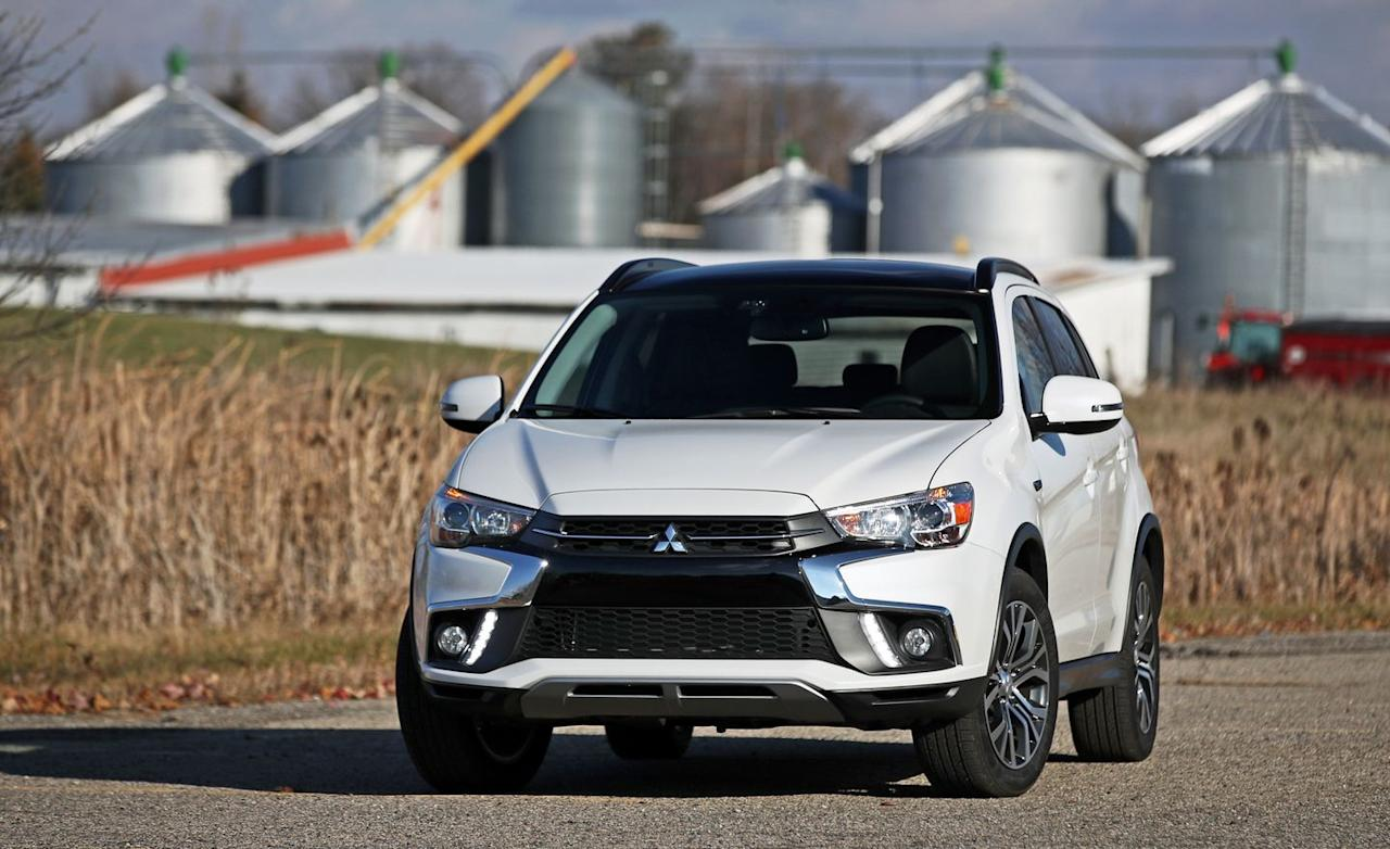 "<p>Beyond its angular good looks, <a href=""https://www.caranddriver.com/mitsubishi/outlander-sport"" target=""_blank"">Mitsubishi's Outlander Sport</a> is a standard-issue small crossover that aspires to little beyond providing value. The base 148-hp 2.0-liter four-cylinder engine comes standard with a five-speed manual transmission—a rarity in this segment—and buyers can upgrade to a continuously variable automatic transmission and all-wheel drive. Need more power? The Mitsubishi offers a 168-hp 2.4-liter engine that comes solely with a CVT.</p>"