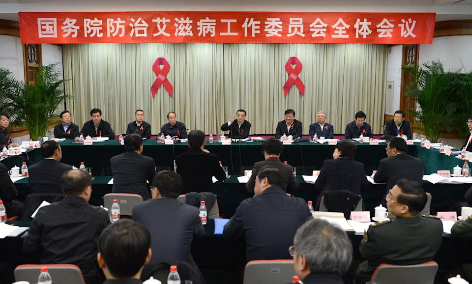 In this photo released by China's Xinhua News Agency, taken on Monday, Nov. 26, 2012, Chinese Vice Premier Li Keqiang presides over the 4th plenary meeting of the State Council AIDS Working Committee, in Beijing, China. During a meeting Monday with a dozen activist groups Li said health facilities that discriminate against people with HIV would be severely punished. An estimated 780,000 people have HIV in China. (AP Photo/Xinhua, Ma Zhancheng) NO SALES