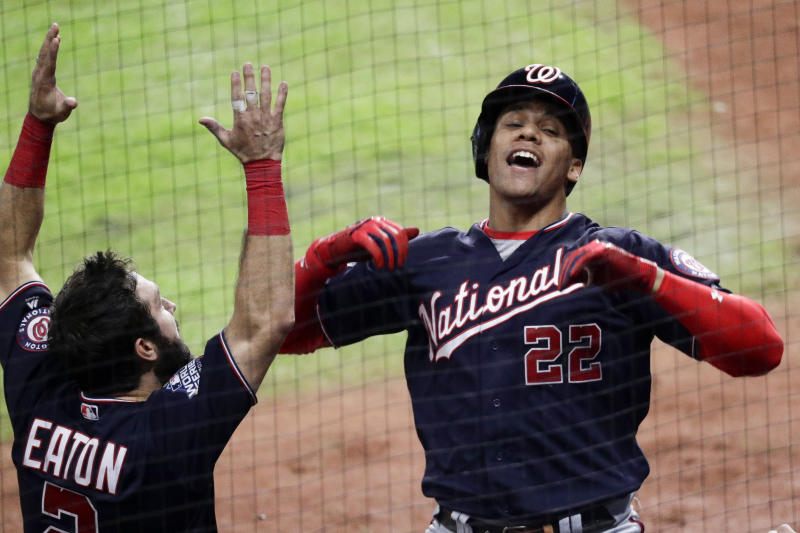 Washington Nationals' Juan Soto, right, celebrates after his home run with Adam Eaton during the fifth inning of Game 6 of the baseball World Series against the Houston Astros Tuesday, Oct. 29, 2019, in Houston. (AP Photo/Sue Ogrocki)