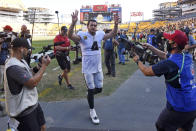 Las Vegas Raiders quarterback Derek Carr (4) waves to fans as he heads to the locker room following an NFL football game against the Pittsburgh Steelers in Pittsburgh, Sunday, Sept. 19, 2021. (AP Photo/Don Wright)