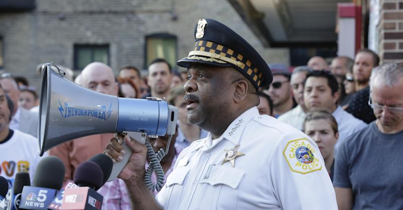 FILE - In this June 12, 2017 file photo, Chicago Police Superintendent Eddie Johnson speaks with with residents of Chicago. Superintendent Johnson visited New York to learn how it has achieved success in fighting crime. Johnson came home with ideas aimed at increasing community trust by using technology to get Chicago police officers out of their squad cars and putting new cadets in neighborhoods to walk the streets. (AP Photo/Teresa Crawford, File)