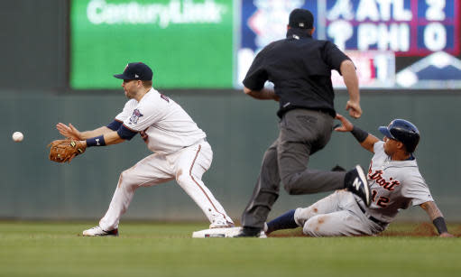 Detroit Tigers' Leonys Martin, right, slides safely into second as Minnesota Twins shortstop Brian Dozier, left, waits for the throw after Nicholas Castellanos grounded to shortstop in the third inning of a baseball game Tuesday, May 22, 2018, in Minneapolis. (AP Photo/Jim Mone)