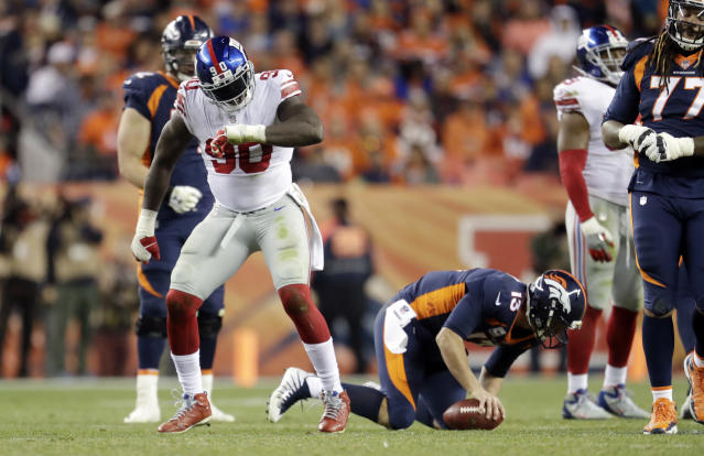 New York Giants defensive end Jason Pierre-Paul (90) reacts after sacking Denver Broncos quarterback Trevor Siemian. (AP)