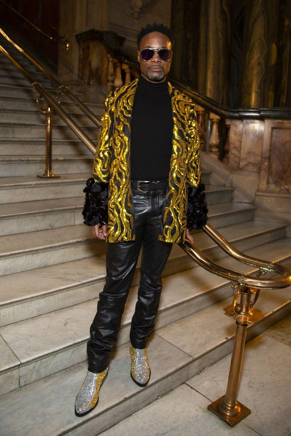 <p>The Halpern fashion show during London Fashion Week proved the perfect opportunity for Porter to wear a gold and black embellished blazer with black leather trousers and silver, glittery boots. </p>