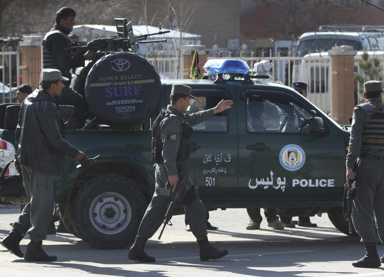 Afghan police men arrive after a suicide bomber wearing a military uniform struck the entrance gate of the Interior Ministry compound in Kabul, Afghanistan, Wednesday, April 2, 2014. Ministry of Interior spokesman Sediq Sediqqi said the bomber, who was wearing a military uniform to evade security checks, reached the entrance of the heavily fortified ministry compound before detonating his explosives. (AP Photo/Massoud Hossaini)