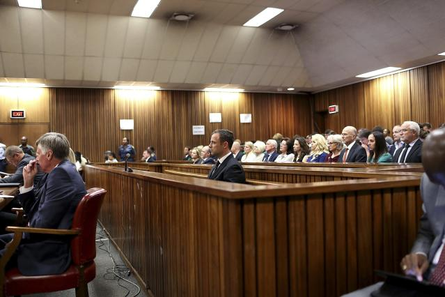 Olympic and Paralympic track star Oscar Pistorius listens to Judge Thokozile Masipa (unseen) deliver her verdict at the North Gauteng High Court in Pretoria September 12, 2014. Pistorius was convicted of culpable homicide on Friday, having escaped the more serious charge of murder for the killing of his girlfriend, Reeva Steenkamp, and could face a lengthy prison sentence. REUTERS/Alon Skuy/Pool (SOUTH AFRICA - Tags: SPORT ATHLETICS CRIME LAW)