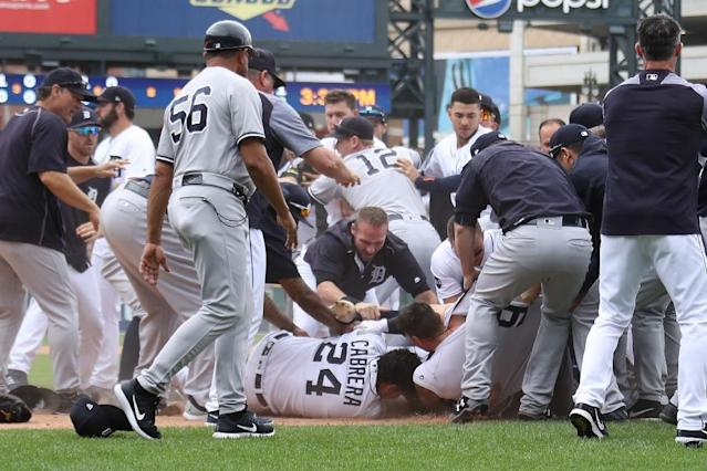 Miguel Cabrera of the Detroit Tigers lays on the ground during a bench-clearing fight with the New York Yankees at Comerica Park on August 24, 2017 in Detroit, Michigan (AFP Photo/Gregory Shamus)