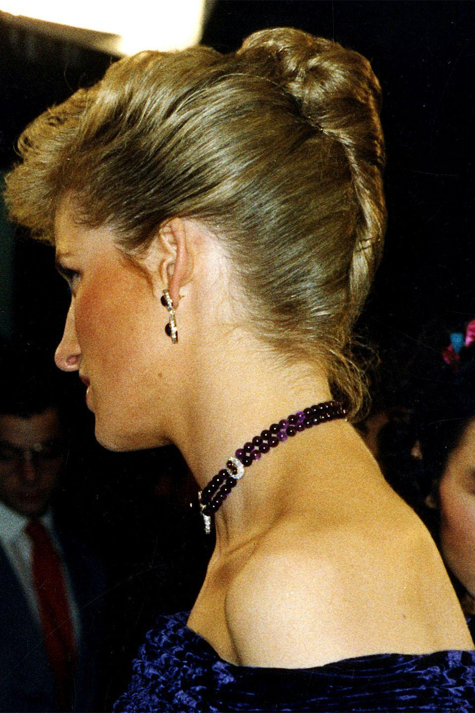 <p>In an elegant French twist updo while attending the Royal Film Performance of <em>Empire of the Sun</em>. </p>