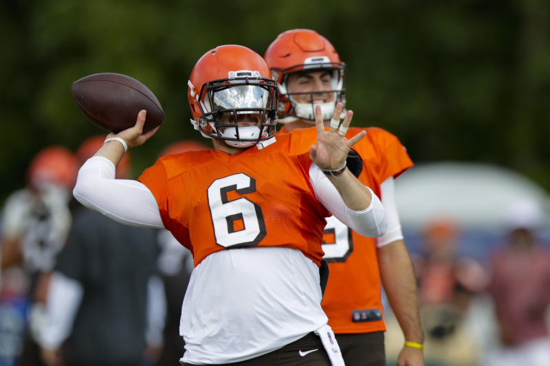 Cleveland Browns quarterback Baker Mayfield (6) throws in front of quarterback David Blough (9) during practice at the NFL team's football training camp in Westfield, Ind., Thursday, Aug. 15, 2019. The Browns held a joint practice with the Indianapolis Colts. (AP Photo/Michael Conroy)