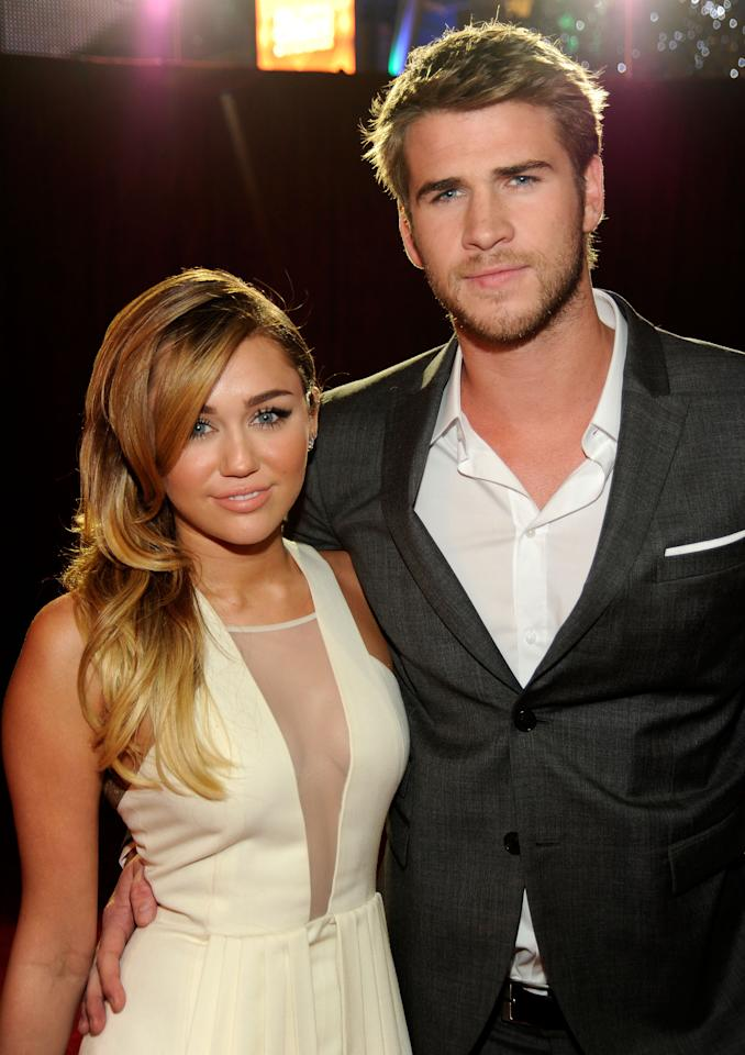 LOS ANGELES, CA - JANUARY 11:  Singer/Actress Miley Cyrus and actor Liam Hemsworth arrive at the 2012 People's Choice Awards at Nokia Theatre L.A. Live on January 11, 2012 in Los Angeles, California.  (Photo by Frazer Harrison/Getty Images for PCA)