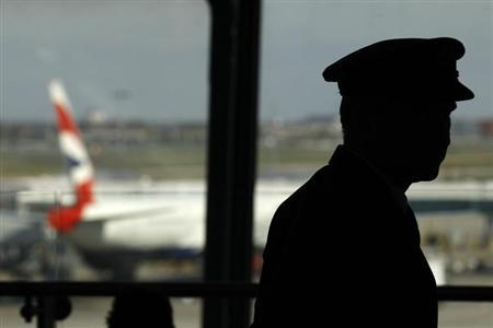 A pilot waits in the departure lounge of BA's Terminal Five at Heathrow Airport in west London