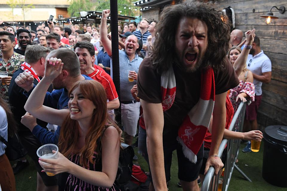 Liverpool supporters in Flat Iron Square in London react to their early opening goal (Photo by Daniel LEAL-OLIVAS / AFP)