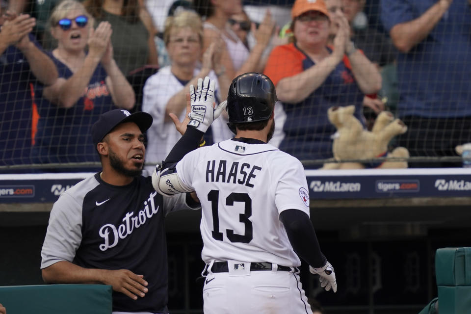 Detroit Tigers' Eric Haase is greeted at the dugout after a solo home run during the fourth inning of a baseball game against the Baltimore Orioles, Saturday, July 31, 2021, in Detroit. (AP Photo/Carlos Osorio)