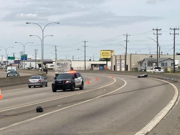 A black helmet and a Honda motorcycle lie on Yellowhead Trail just west of Fort Road on Wednesday morning after a fatal motorcycle collision. (Jamie McCannel/CBC - image credit)