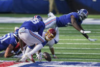 Washington Football Team quarterback Kyle Allen (8) loses control of the ball and watches New York Giants linebacker Tae Crowder (48) recover it during the second half of an NFL football game Sunday, Oct. 18, 2020, in East Rutherford, N.J. Crowder scored a touchdown on the play. (AP Photo/John Minchillo)
