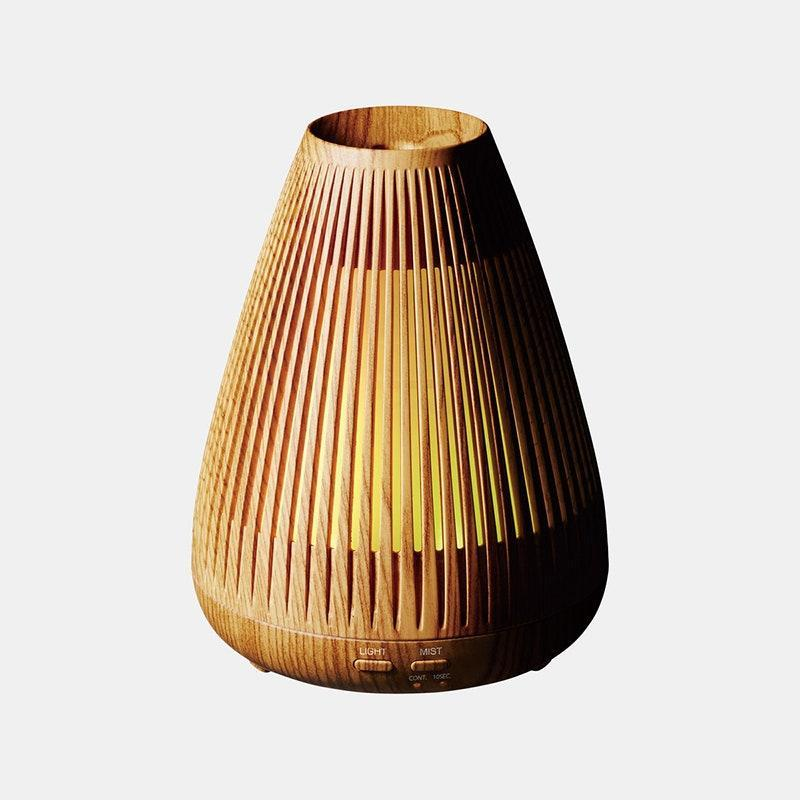 """<p>It's hard to decide whether we like the Objecto W2 Aroma Diffuser as a diffuser or an <em>objet d'art</em>. And thankfully, we don't have to. This high-performing diffuser releases a steady (and silent!) stream of vapor powerful enough to fill any room with subtle scent, but the wooden slatted casing is so eye-catching that you'll want to give it the place of honor on your shelf.</p> <p><strong>$70</strong> (<a href=""""https://click.linksynergy.com/deeplink?id=MZ9491VLjxM&mid=45762&u1=allurebestessentialoildiffusers&murl=https%3A%2F%2Fwww.verishop.com%2Fobjecto%2Fdiffuser%2Fw2-aroma-diffuser%2Fp4164272848919"""" rel=""""nofollow noopener"""" target=""""_blank"""" data-ylk=""""slk:Shop Now"""" class=""""link rapid-noclick-resp"""">Shop Now</a>)</p>"""