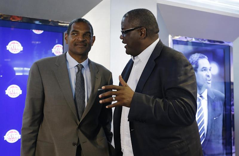 Detroit Pistons' President of Basketball Operations Joe Dumars, right, talks with Maurice Cheeks, left, after Cheeks was introduced as the Pistons new head coach during a news conference at The Palace of Auburn Hills, Mich., Thursday, June 13, 2013. Cheeks joins the Pistons after serving four years as an assistant coach with Oklahoma City. (AP Photo/Carlos Osorio)