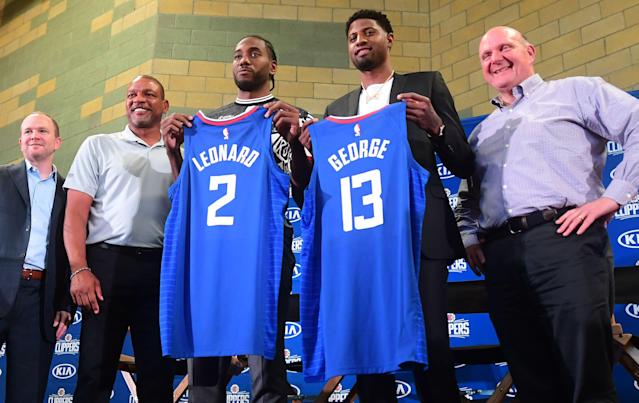 """With the summer additions of <a class=""""link rapid-noclick-resp"""" href=""""/nba/players/4896/"""" data-ylk=""""slk:Kawhi Leonard"""">Kawhi Leonard</a> and <a class=""""link rapid-noclick-resp"""" href=""""/nba/players/4725/"""" data-ylk=""""slk:Paul George"""">Paul George</a>, the <a class=""""link rapid-noclick-resp"""" href=""""/nba/teams/la-clippers/"""" data-ylk=""""slk:Clippers"""">Clippers</a> are among the favorites to win the NBA Finals this season. (Frederic J. Brown/AFP)"""