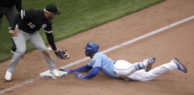 Kansas City Royals' Jorge Soler beats the tag by Chicago White Sox third baseman Yoan Moncada (10) to advance to third on a throwing error by shortstop Tim Anderson after hitting a two-run double during the sixth inning of a baseball game Saturday, March 30, 2019, in Kansas City, Mo. (AP Photo/Charlie Riedel)