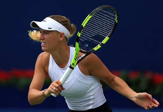 Caroline Wozniacki of Denmark plays a shot against Sloane Stephens of the US during their WTA Rogers Cup semi-final match, at Aviva Centre in Toronto, Canada, on August 12, 2017 (AFP Photo/Vaughn Ridley)
