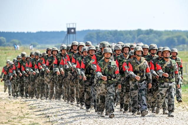 <p>Soldiers of the People's Liberation Army (People's Republic of China) march in formation during the Open Water contest between pontoon bridge units at the 2018 International Army Games on the Oka River, Vladimir Region, Russia, Aug. 3, 2018. (Photo: Sergei Bobylev/TASS via Getty Images) </p>