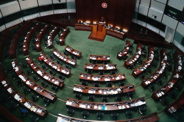 Hong Kong's Legislative Council attend a council meeting to discuss the controversial national anthem bill in Hong Kong