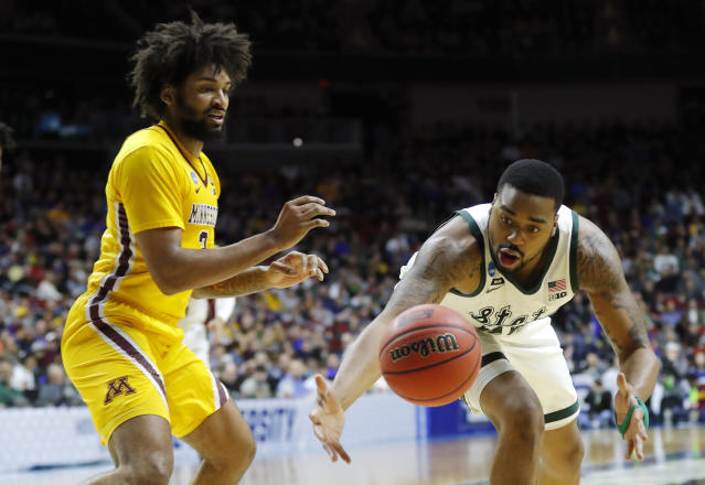 <p>Michigan State forward Nick Ward, right, picks up a loose ball in front of Minnesota forward Jordan Murphy, left, during a second round men's college basketball game in the NCAA Tournament, Saturday, March 23, 2019, in Des Moines, Iowa. (AP Photo/Charlie Neibergall) </p>