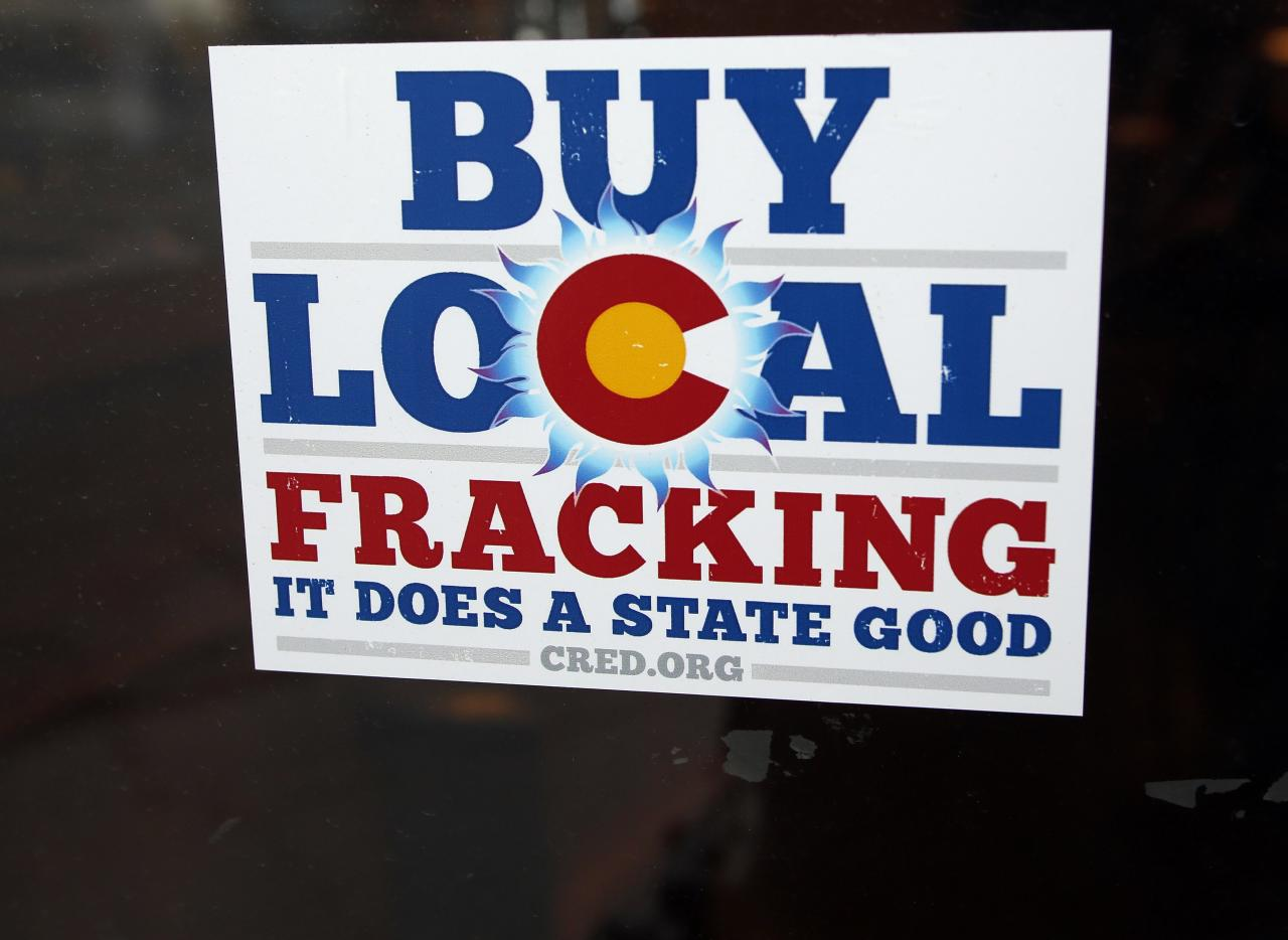 "A sign supporting fracking on the doorway at Mama's Restaurant in Parachute, Colorado, December 10, 2014. The economy of Parachute, with a current population of approximately 1000 people, was devastated when thousands of workers lost their jobs on ""Black Sunday"" in 1982, after Exxon terminated the Colony Shale Oil Project. The current rise of hydraulic fracking in natural gas retrieval has given a cautious hope to the town's inhabitants, who know that market demand brings both boom and bust. Picture taken December 10, 2014.  REUTERS/Jim Urquhart (UNITED STATES  - Tags: ENERGY BUSINESS)"