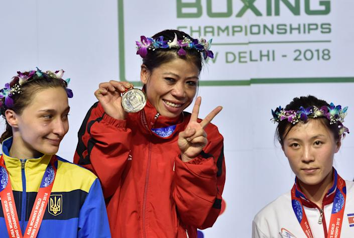 Mary Kom clinches historic sixth gold medal during AIBA Women's World Boxing Championships 2018, at IG Stadium, on November 24, 2018 in New Delhi, India. Mary Kom became the most successful boxer in the history of Women's World Championships by winning her sixth gold medal with an unanimous 5-0 result over Ukraine's Hanna Okhota. (Photo by Sanjeev Verma/Hindustan Times via Getty Images)