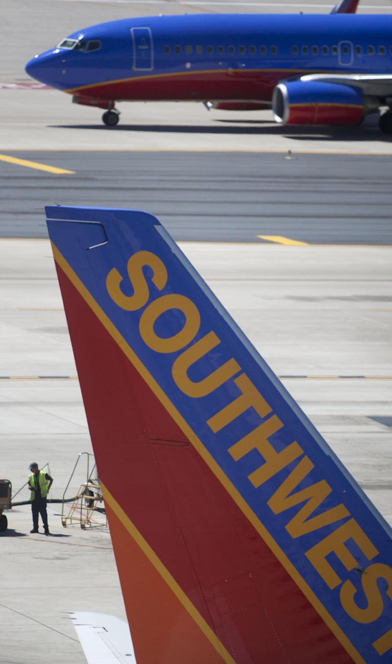 FILE - In a Monday, April 4, 2011 file photo, a Southwest Airlines jetliner maneuvers around the tarmac at Phoenix Sky Harbor International Airport in Phoenix. Southwest Airlines says it made $98 million in the first quarter of 2012, helped by one-time gains on fuel-hedging contracts.   (AP Photos/The Arizona  Republic, Nick Oza, File) MARICOPA COUNTY OUT; MAGS OUT; NO SALES
