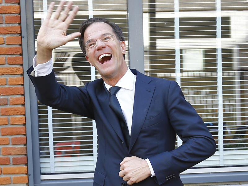 Dutch Prime Minister Mark Rutte of the VVD party waves after voting in the general election: REUTERS