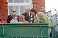 <p>Singer Cliff Richard joined Princess Diana in the royal box during the Stella Artois Championships in London. He looked appropriate for the summer event in a light green linen sport coat and patterned tie. </p>