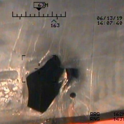U.S. Pentagon in Washington releases handout imagery that it says shows damage from mines to commercial ships in Gulf of Oman - Credit: Reuters