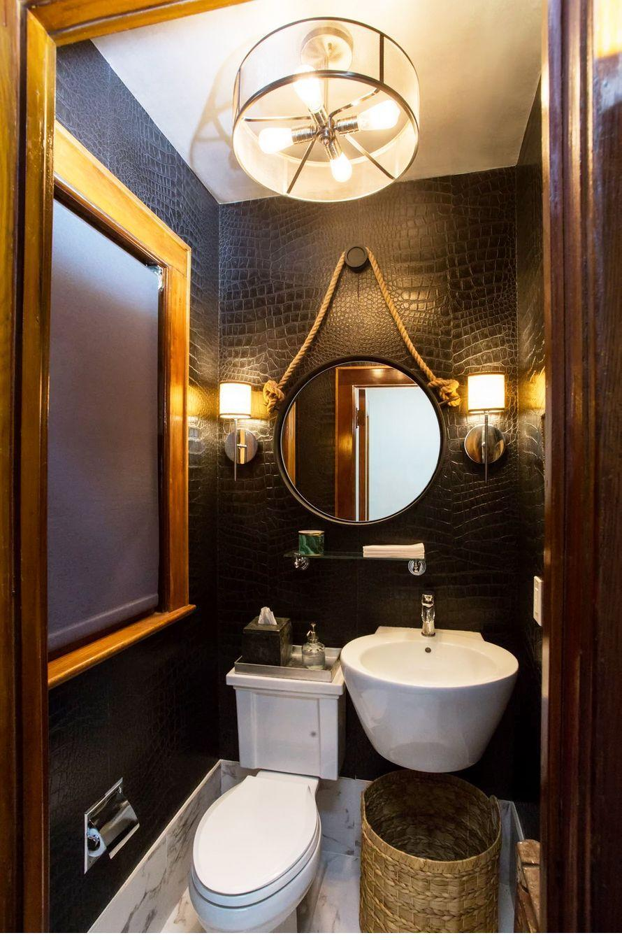 """<p>In a small powder room, a floating shelf will be a life-saver for essentials like washcloths, hand soap, candles, and tissues. Interior designer <a href=""""https://www.gaildavisdesignsllc.com/"""" rel=""""nofollow noopener"""" target=""""_blank"""" data-ylk=""""slk:Gail Davis"""" class=""""link rapid-noclick-resp"""">Gail Davis</a> installed a simple glass shelf right under the mirror for a nice symmetrical display. </p>"""